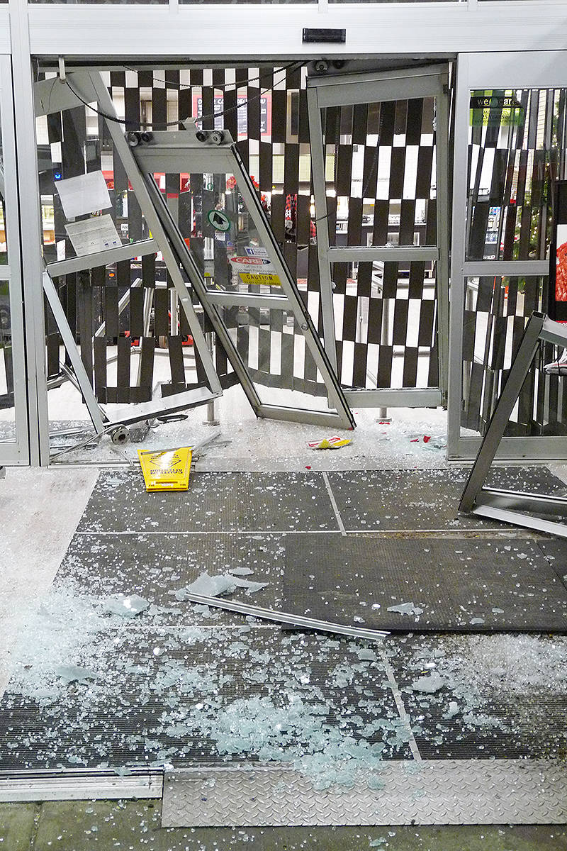 An attempt to use a vehicle to smash through the entrance of the Otter Co-op left debris strewn about but was apparently unsuccessful. Dan Ferguson Langley Times