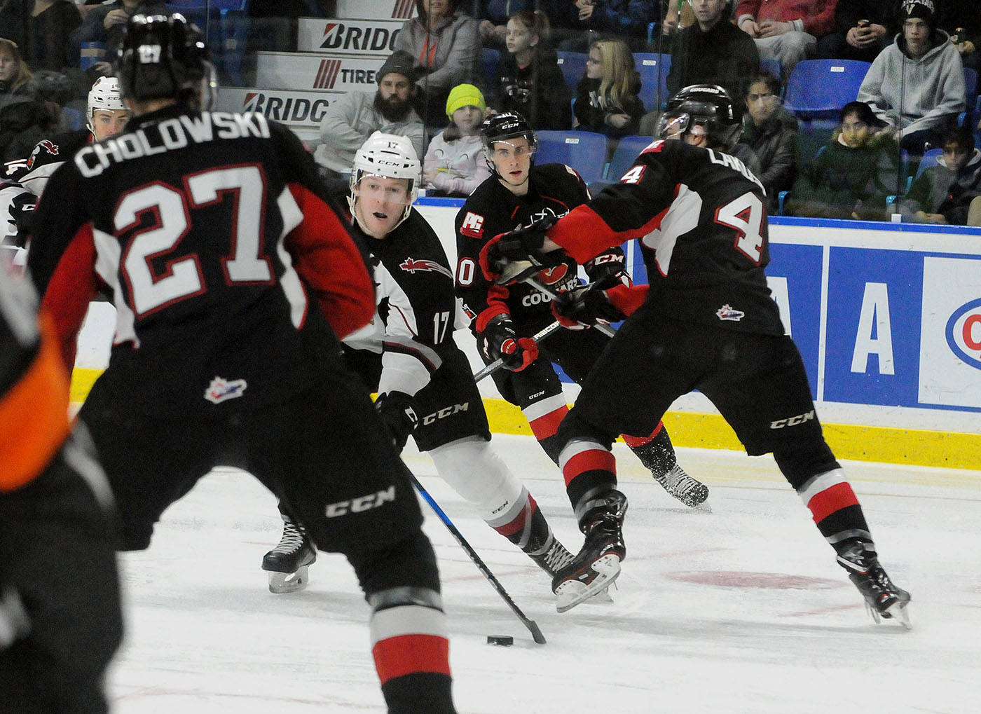 As he enters the Prince George Cougars zone, Vancouver Giants captain Tyler Benson weighs his options with the puck. The Giants hosted the Cougars in WHL action Saturday at the Langley Events Centre. Troy Landreville Black Press