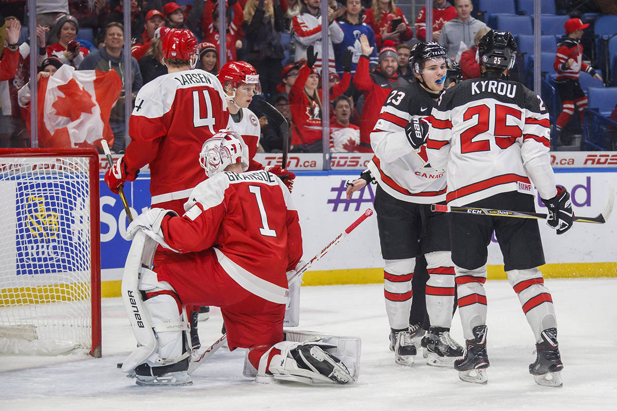 Canada's Sam Steel (23) celebrates his goal with teammate Jordan Kyrou (25) against Denmark's Emil Gransoe (1) and Christian Larsen (4) during first period IIHF World Junior Championship preliminary action in Buffalo, N.Y., on Saturday. THE CANADIAN PRESS