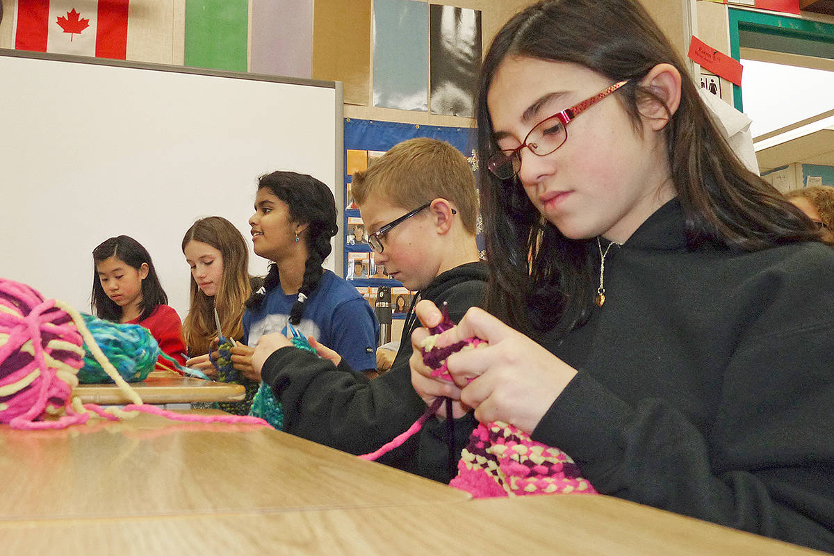 Some of the Grade 7 French Immersion students at Alex Hope Elementary who knitted scarves for the homeless. (L to R) Cici Wang, Sara Walmsley, Julia Abraham, Ryan Moore and Erin Docherty. Dan Ferguson Langley Times
