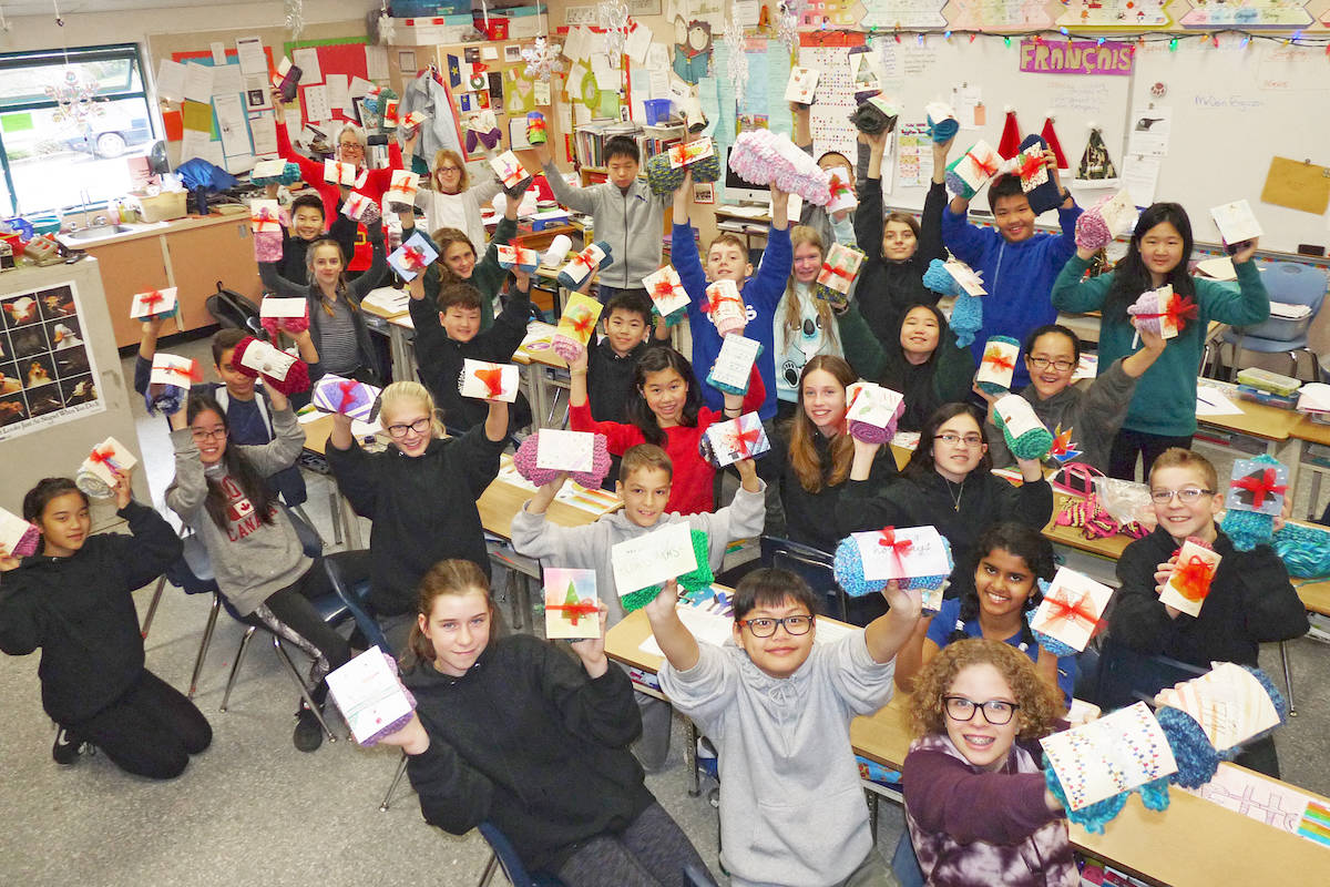 Students in the Grade 7 French immersion class at Alex Hope Elementary in Langley made 70 scarves and hand-made gift cards for the homeless. Dan Ferguson Langley Times