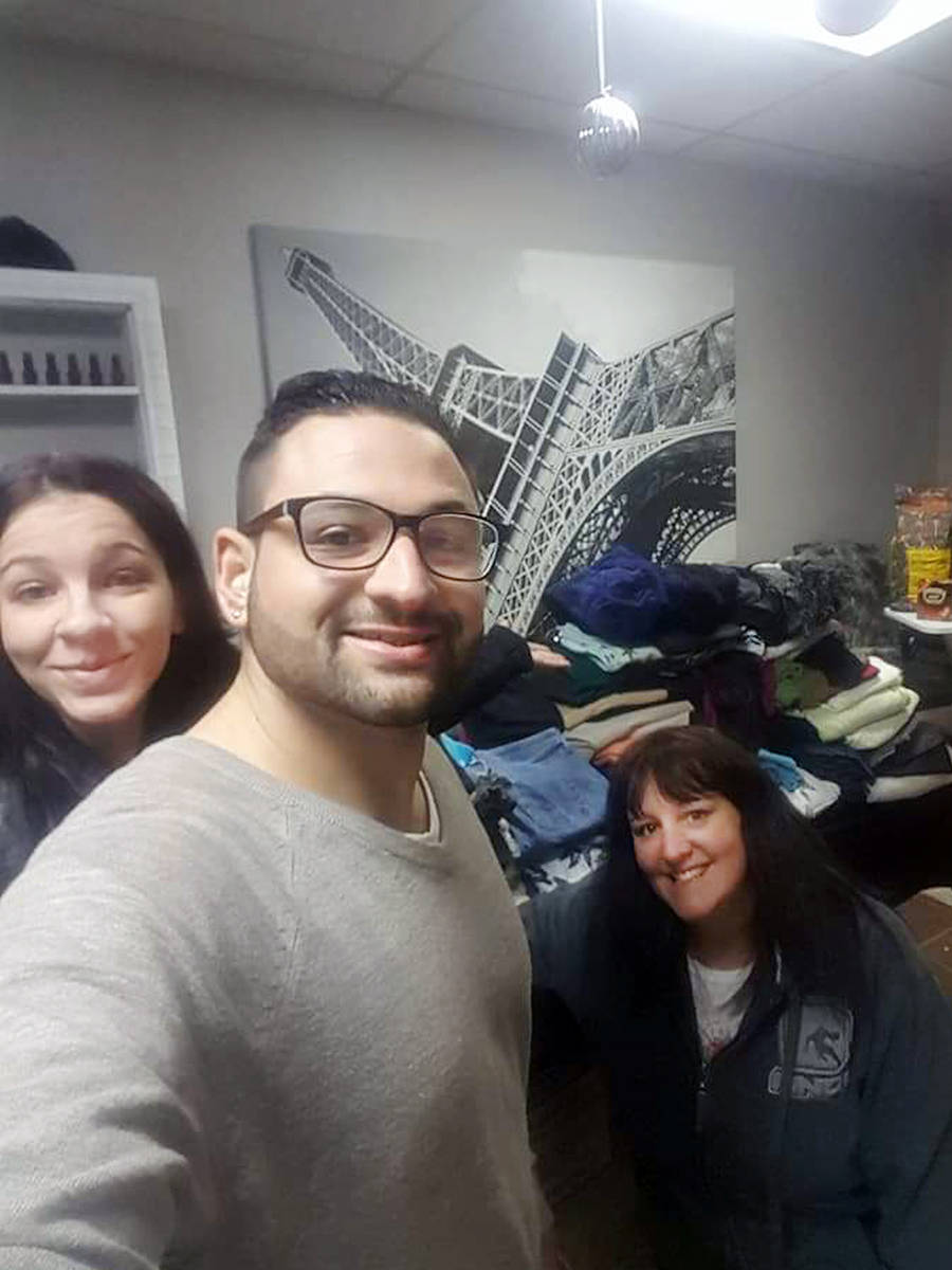 """""""We're Here To Help"""" organizer Augustino Duminuco with Courtney Smith (L), who donated the use of her salon and (R) Melanie Grant, donations coordinator for the Infinite Expansion Foundation. Supplied"""