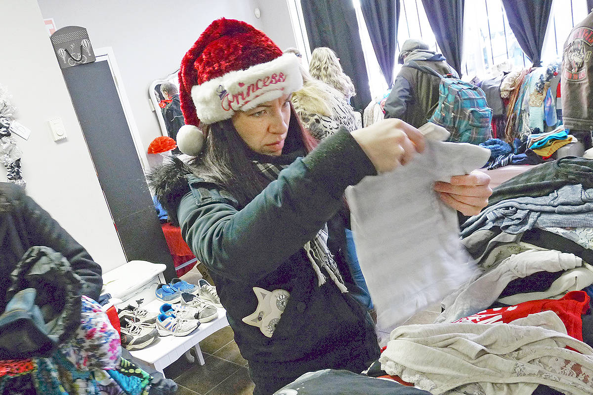 L'amour de soi owner Courtenay Smith was handing out clothing to people in need. Smith volunteered her Langley City beauty salon as a distribution centre for the second annual We're Here To help event organized by Infinite Expansion Foundation head Augustino Duminuco. Dan Ferguson Langley Times