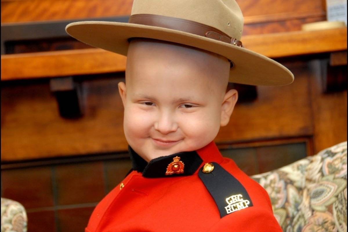 Keian Blundell became an honourary RCMP officer and was given a custom-made red serge which he wore proudly. With support from RCMP, Keian continued his Holiday Wish Toy Drive until he passed away from cancer Jan. 1, 2014. Now RCMP continue the toy drive for him. RCMP photo