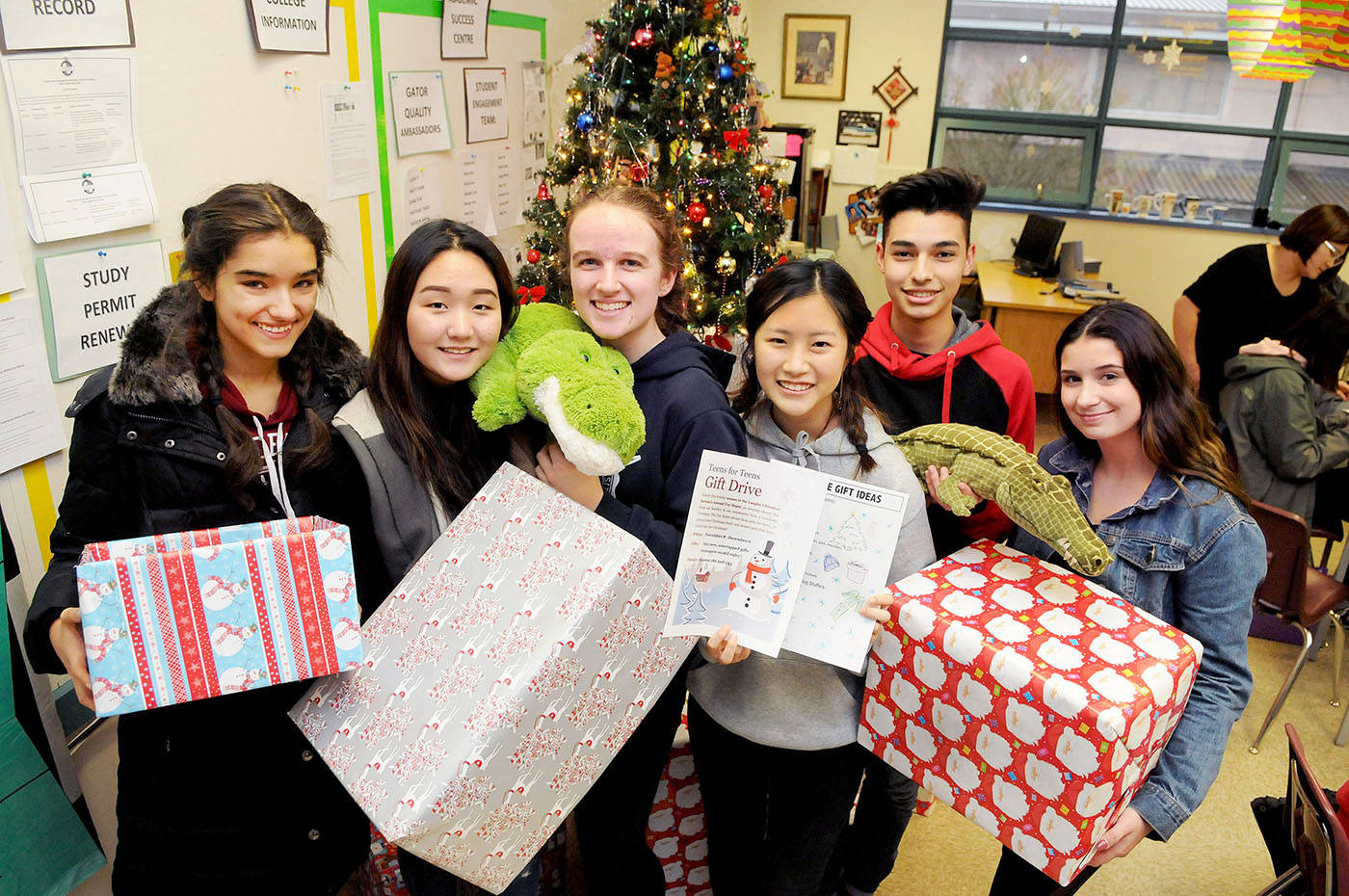 Walnut Grove Secondary students who are collecting winter clothing for the school's Warm Hands Warm Hearts initiative, and gifts orientated for youth for the Langley Christmas Bureau, gathered for a photo at the school recently. Troy Landreville Langley Times