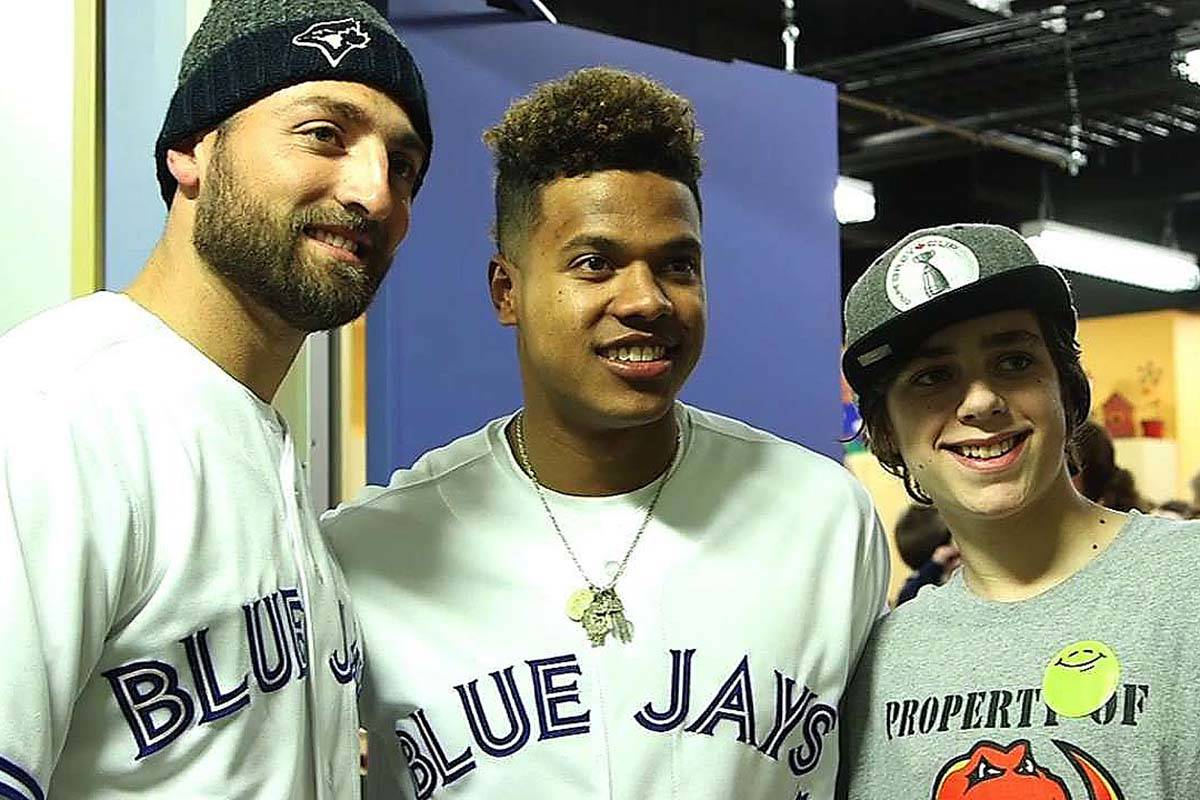 Toronto Blue Jays stars Kevin Pillar (left) and Marcus Stroman (middle) pose for a photo with a young fan during a Winter Tour event in Calgary in 2015. (Photo: MLB.com)