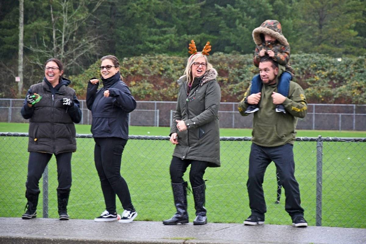 Parents of students at Brookswood Secondary broke out into dance in the parking lot on Friday, Dec. 1. See video of their dance moves online at www.langleytimes.com.                                Miranda Gathercole Langley Times