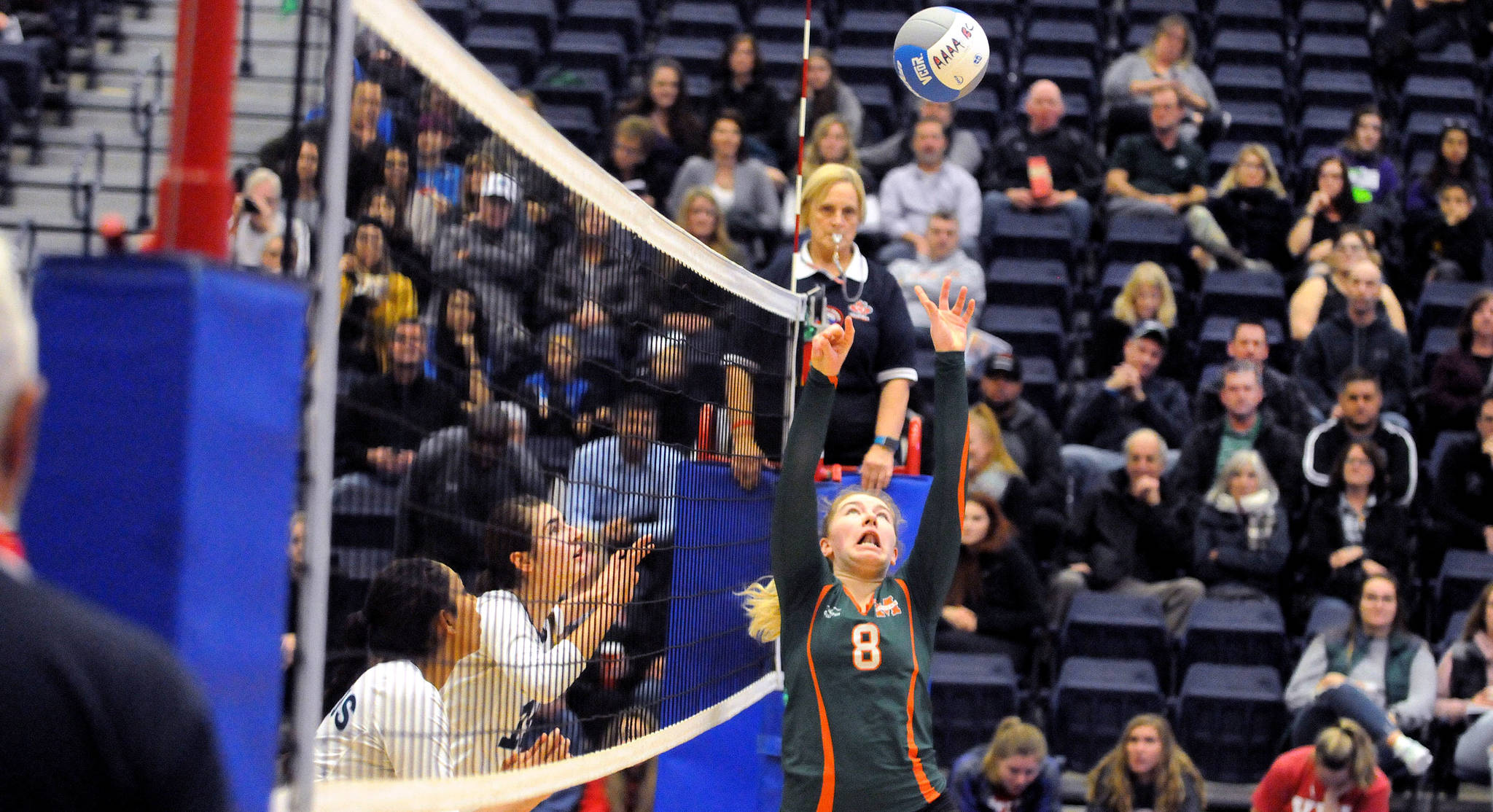 Earl Marriott Mariners' Stephanie Mrakuzie set up a spike against the Seaquam Seahawks during the 4A girls quarter-finals, part of the Big Kahuna BC Volleyball Championships at the Langley Events Centre. Troy Landreville Black Press