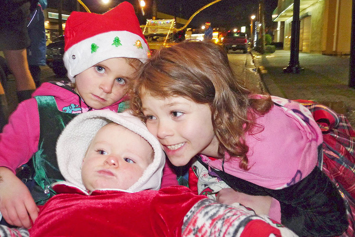 Parade watchers Heather Pearce, 4 1/2, Violet Pearce, 10 months, and Lilyann Pearce, 6. Dan Ferguson Langley Times