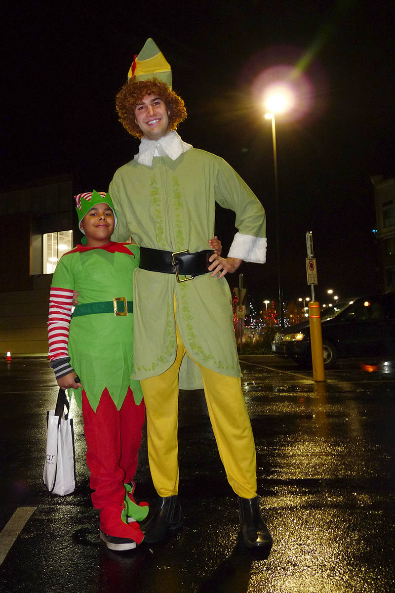 The rather tall elf kept running up to strangers to ask them what their favourite colour was. Dan Ferguson Langley Times