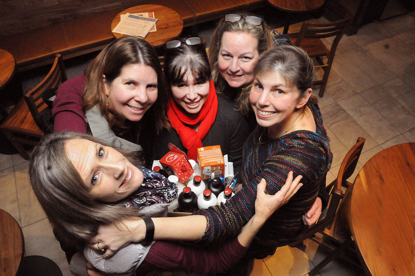 A group of moms have stayed connected since their kids were babies 15 years ago. Through the group Women Helping Women South Delta, they help contribute personal care items for women escaping abusive relationships. The women, who met at the Langley Health Clinic in 2003, got together for a group hug at the Brookswood Starbucks recently.                                 Troy Landreville Langley Times