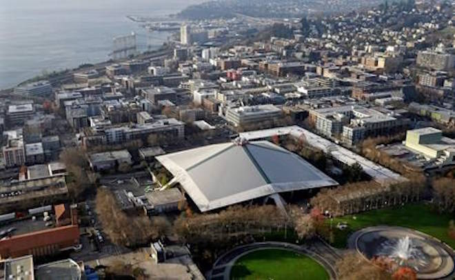 The iconic sloped roof of KeyArena, center, a sports and entertainment venue at the Seattle Center, is seen from above Monday, Dec. 4, 2017, in Seattle. (AP Photo/Elaine Thompson)