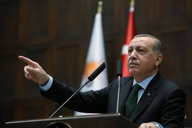 Turkey's President Recep Tayyip Erdogan gestures as he delivers a speech during a meeting of his ruling Justice and Development Party (AKP), in Ankara, Turkey, Tuesday, Dec. 5, 2017. (Yasin Bulbul/Pool via AP)