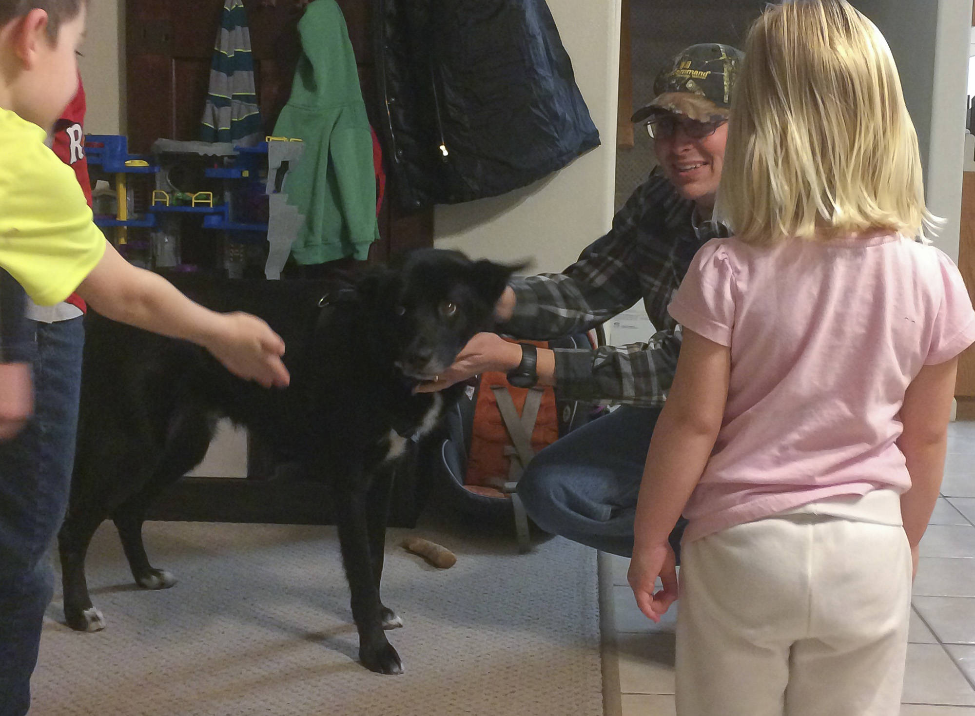 Submitted Photo                                Jeff Hayes and family reunite with Yukon the dog after truck driver Nicholas Stoneburgh drove him up the Alaska Highway to Beaver Creek.