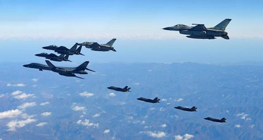 In this photo provided by South Korea Defense Ministry, U.S. Air Force B-1B bomber, far left, South Korea and U.S. fighter jets fly over the Korean Peninsula during the combined aerial exercise, South Korea, Wednesday, Dec. 6, 2017. (South Korea Defense Ministry via AP)