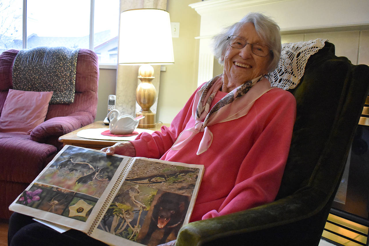 103-year-old Elfreda Anderson's travelling days are done, for now. She saved brochures and photos from each place she went and glued it into a Mead notebook. (Grace Kennedy photo)