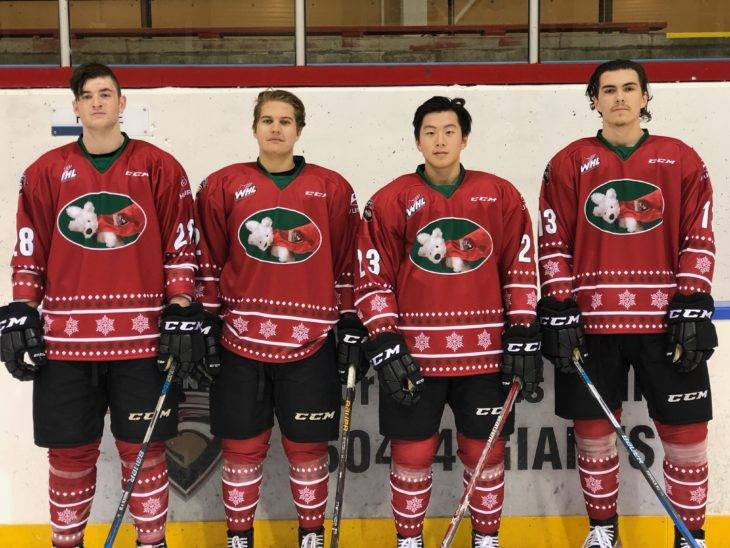 Darian Skeoch (left to right), Marcus Kichton, Tyler Ho and Tyler Popowich model the special jerseys the Vancouver Giants will wear on Dec. 17 as part of the team's annual Teddy Bear Toss at the Langley Events Centre. The jerseys will also be auctioned off with proceeds going to the Lower Mainland Christmas Bureau. Vancouver Giants photo