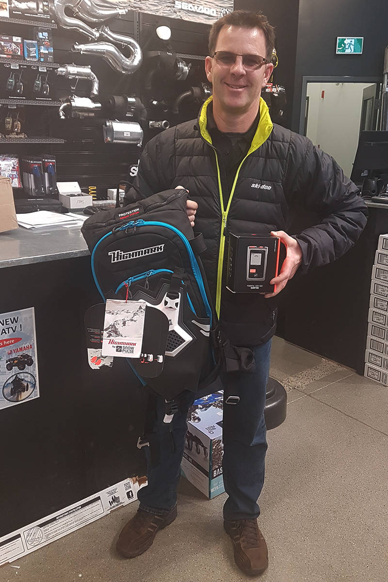 Mike Skiba, owner of Greater Vancouver Powersports, with some of the essential safety gear for those heading out on the snow.