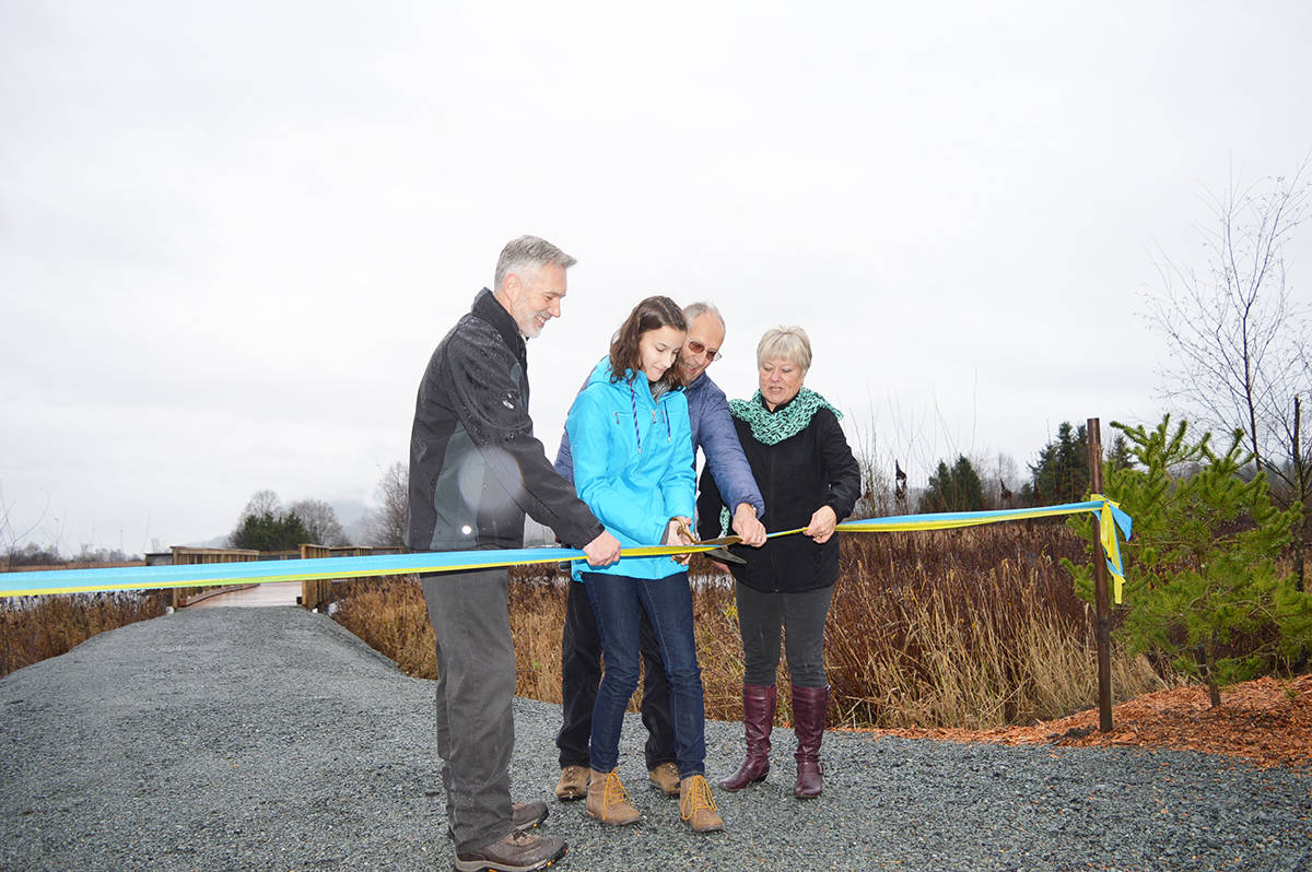 Cutting the ribbon for the Willband wildlife viewing platform, from left, Abbotsford City councillor Ross Siemens, student Abigail Van Deventer, Nature Club representative Hank Roos, Otter Co-Op board president Angie McDougall.
