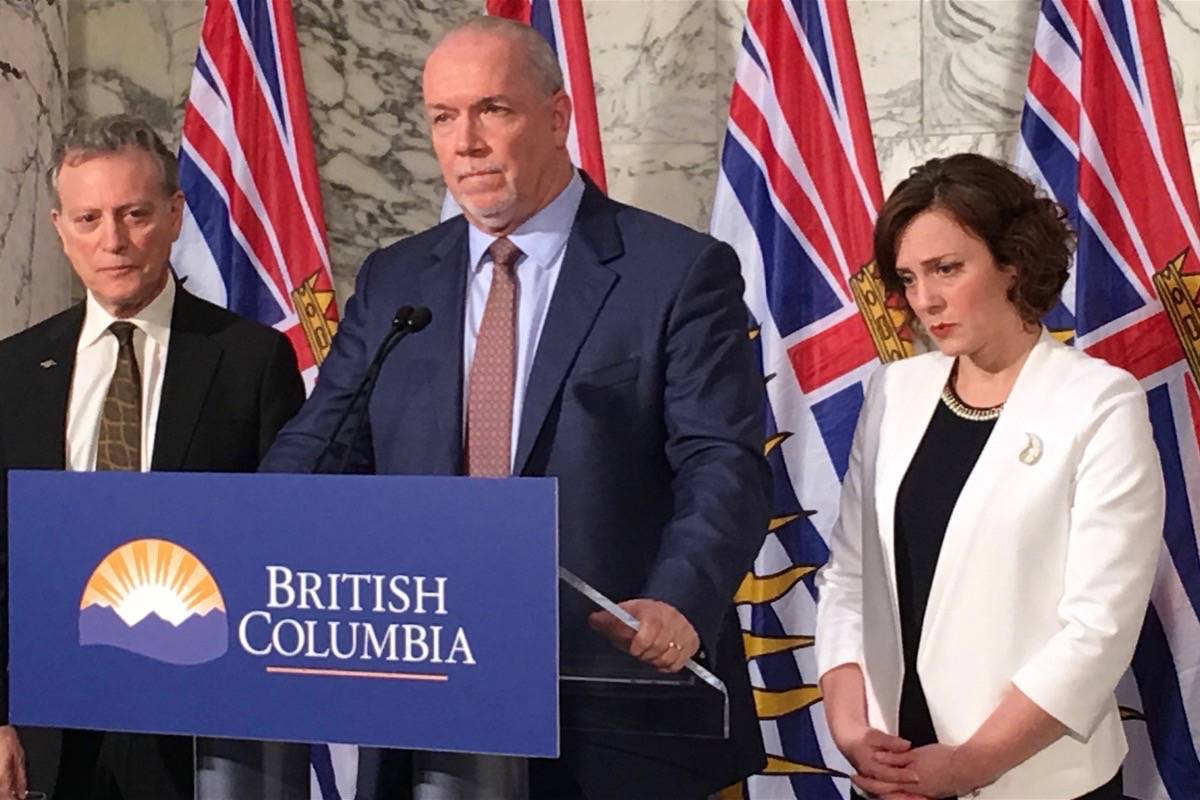 Environment Minister George Heyman, Premier John Horgan and Energy Minister Michelle Mungall announce decision to proceed with construction of the Site C dam, B.C. legislature library, Dec. 11, 2017. (Ragnar Haagen/Black Press)