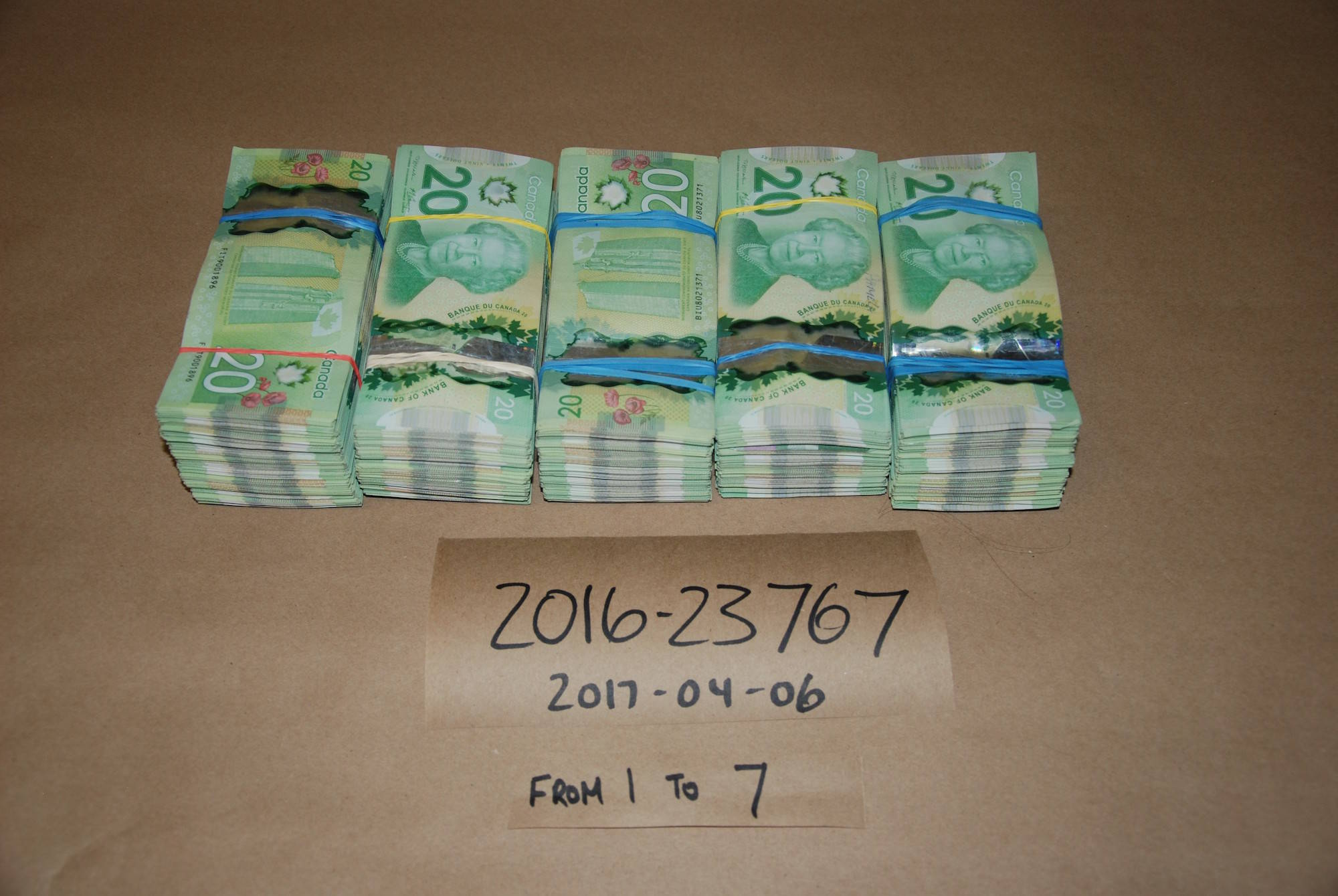"""""""Cash Seized from CHAPPELL's Residence. March 30, 2017."""" Image credit: Kamloops RCMP"""