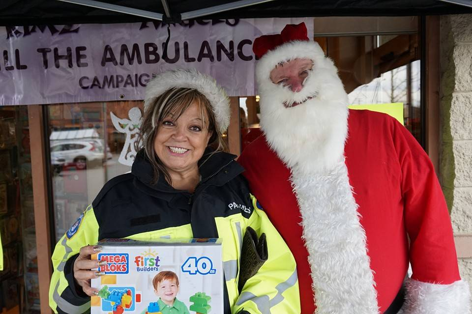 Kim Snow, founder of Kimz Angels with Santa at last year's Fill the Ambulance campaign where diapers, baby food, toys and non-perishable food is donated and filled in an ambulance Dec. 16 and 17. Langley Times file photo