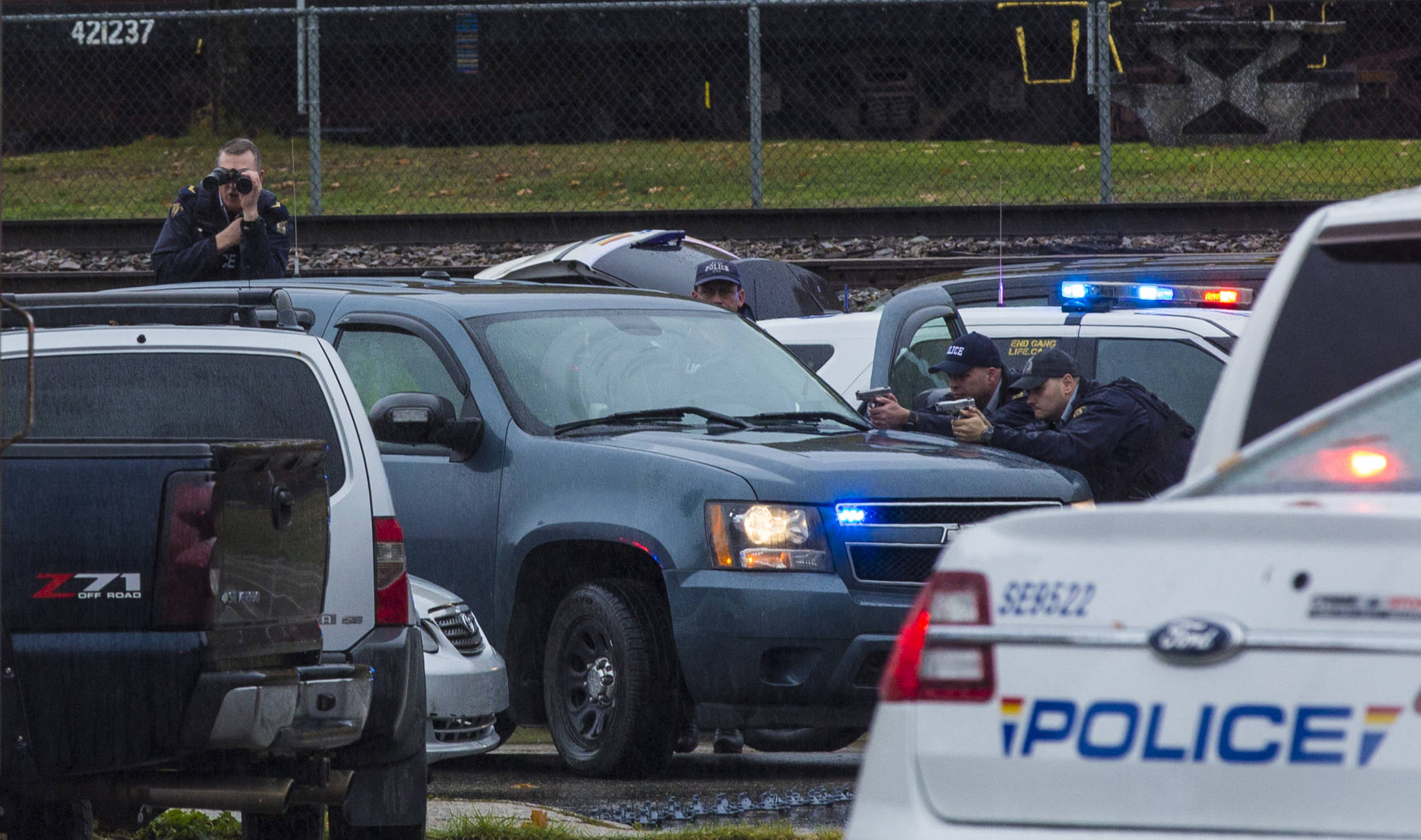 RCMP officers point their weapons at the vehicle of Mohammadali Darabi on Oct. 17. (Marissa Tiel/ Revelstoke Review)