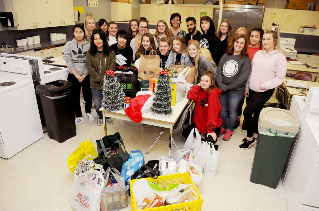 DW Poppy Secondary teacher Carrie Fast and her Family Management 11-12 students gathered around food they are collecting for struggling families this Christmas. Troy Landreville Langley Times