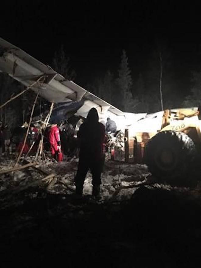 RCMP say a plane with 25 people on board has crashed in northern Saskatchewan shortly after taking off around 6:15 p.m. Wednesday at the Fond du Lac airport. First responders work the crash scene near the Fond du Lac airport in a Wednesday, December 13, 2017, image posted to social media. THE CANADIAN PRESS/HO-Facebook, Raymond Sanger.