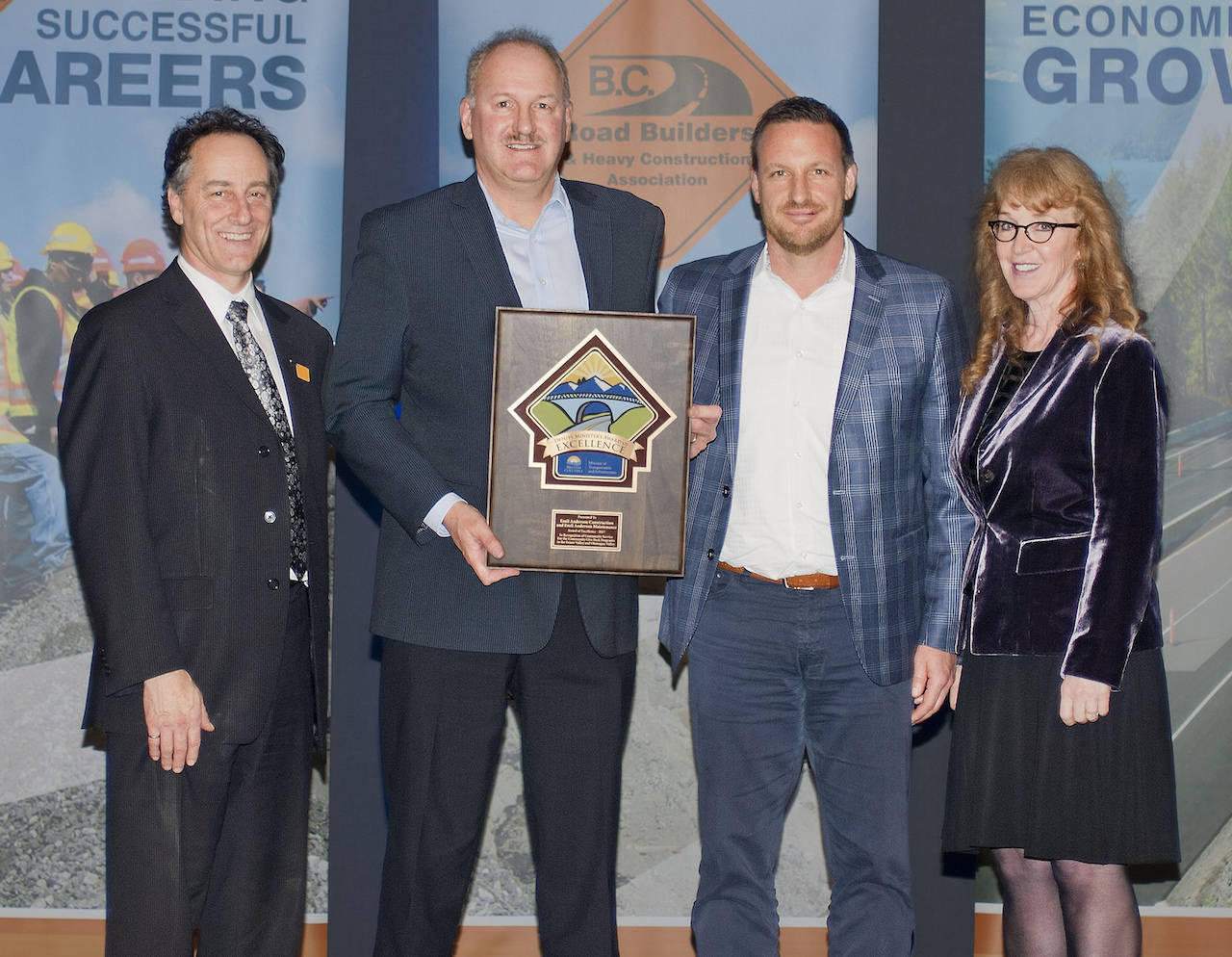Emil Anderson Construction and Emil Anderson Maintenance reps Mike Jacobs and Robert Hasell (middle two) accepted an award for community service at the Deputy Minister's Contractor of the Year awards Friday in Victoria. (Submitted)