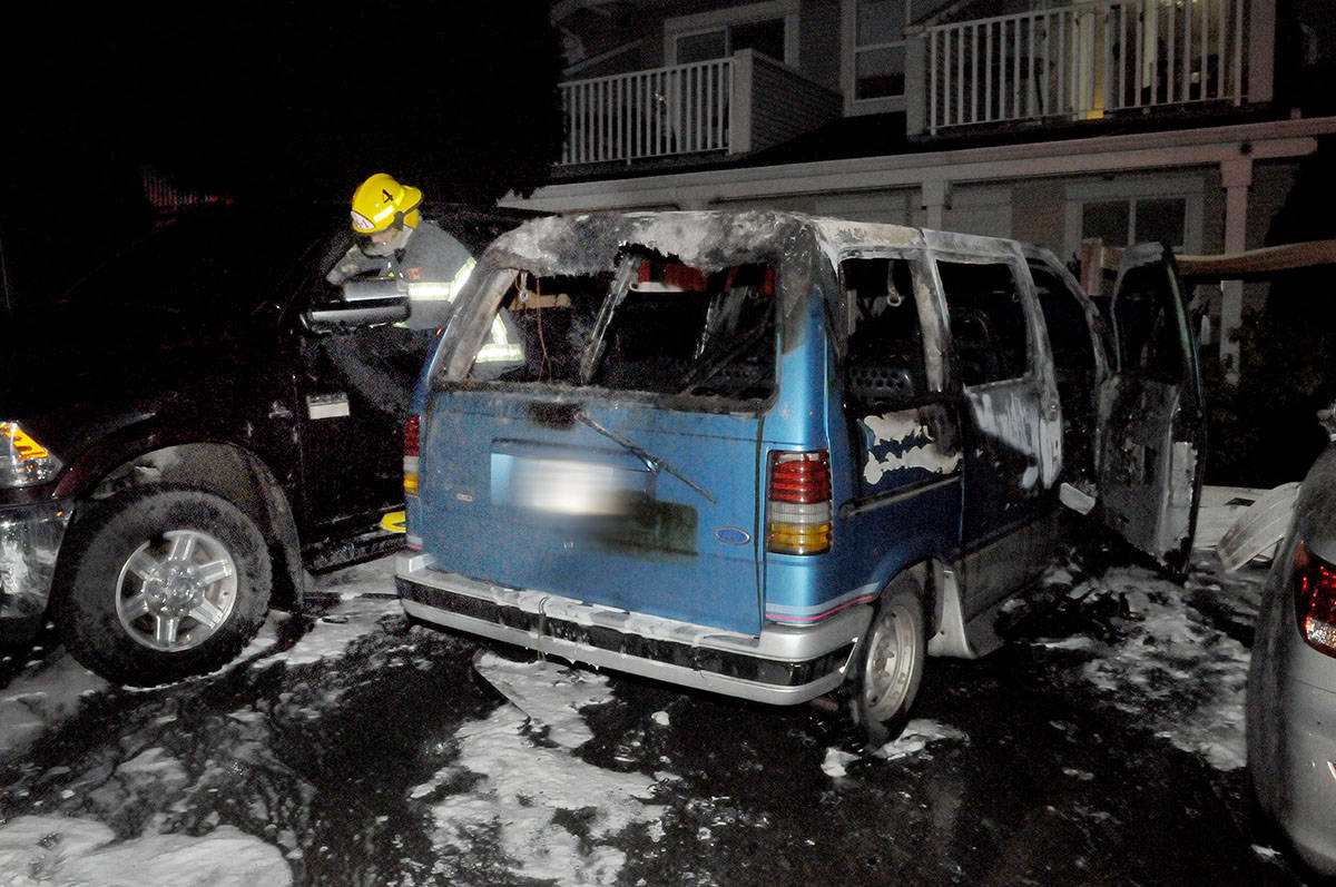 A van parked on a lot along 64 Avenue just west of 200 Street late was completely destroyed by fire Friday afternoon. Troy Landreville Black Press
