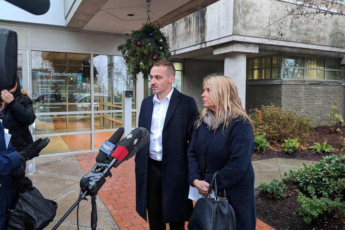 Mother Jennifer Brooks and son Beaudry address media outside Surrey RCMP detachment Tuesday morning. (Aaron Hinks photo)