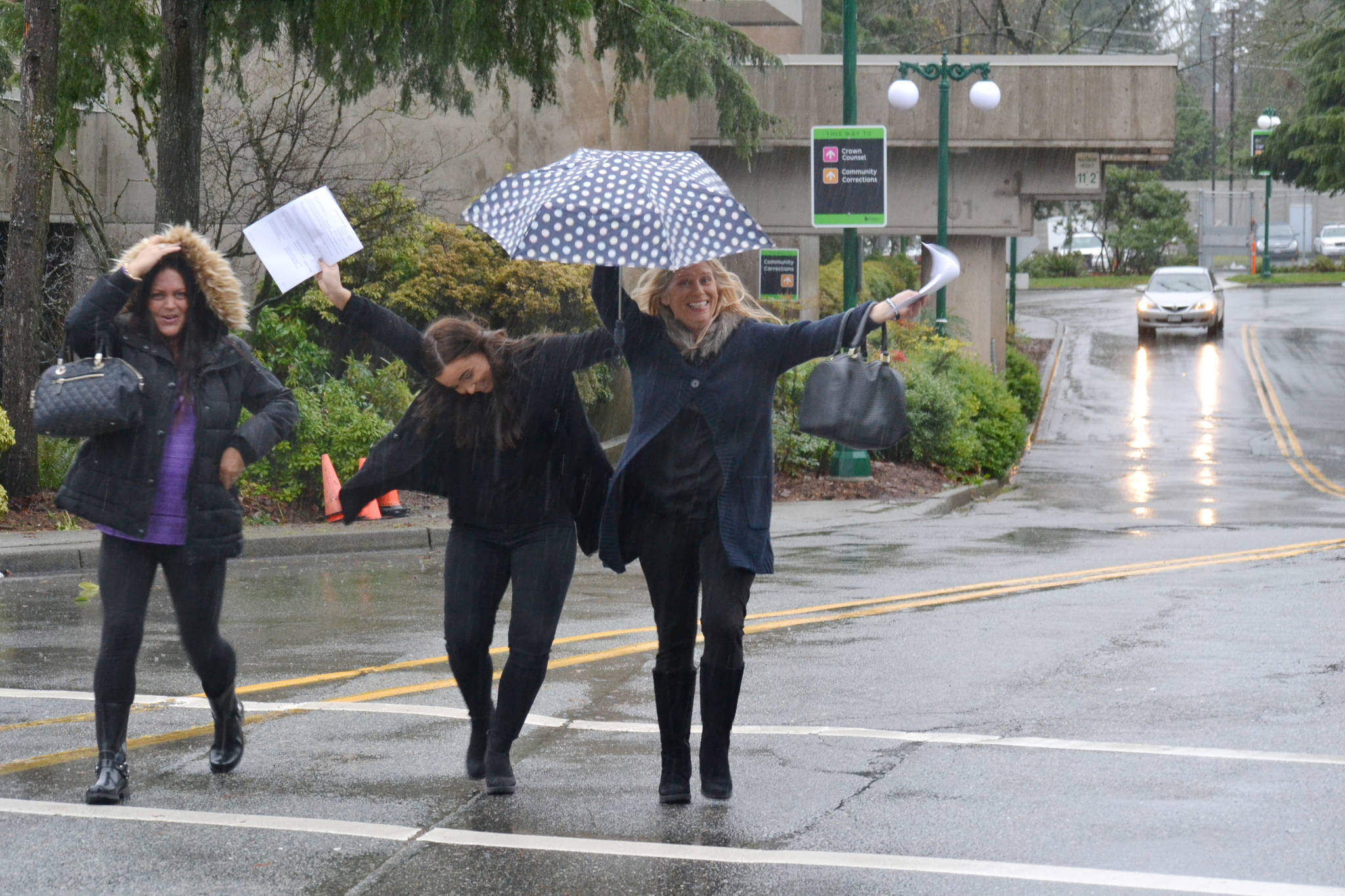Aaron Hinks photo                                 Elated mother Jennifer Brooks and daughter Shayla hold documents Tuesday outlining charges against a Surrey RCMP officer in the 2015 death of Hudson Brooks.