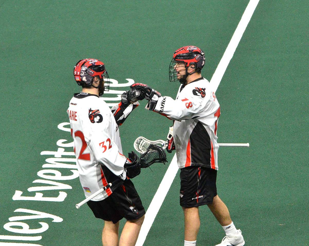 Vancouver Stealth's Logan Schuss (right) and James Rahe celebrate a goal during NLL action at the Langley Events Centre on Dec. 8. Gary Ahuja Langley Times
