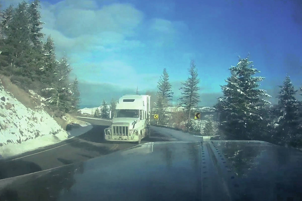 Imagine rounding a mountain bend and to see a transport truck coming towards you in your own lane. That is the image captured by this dash cam, during a near miss on Highway 3 near Sunday Summit.