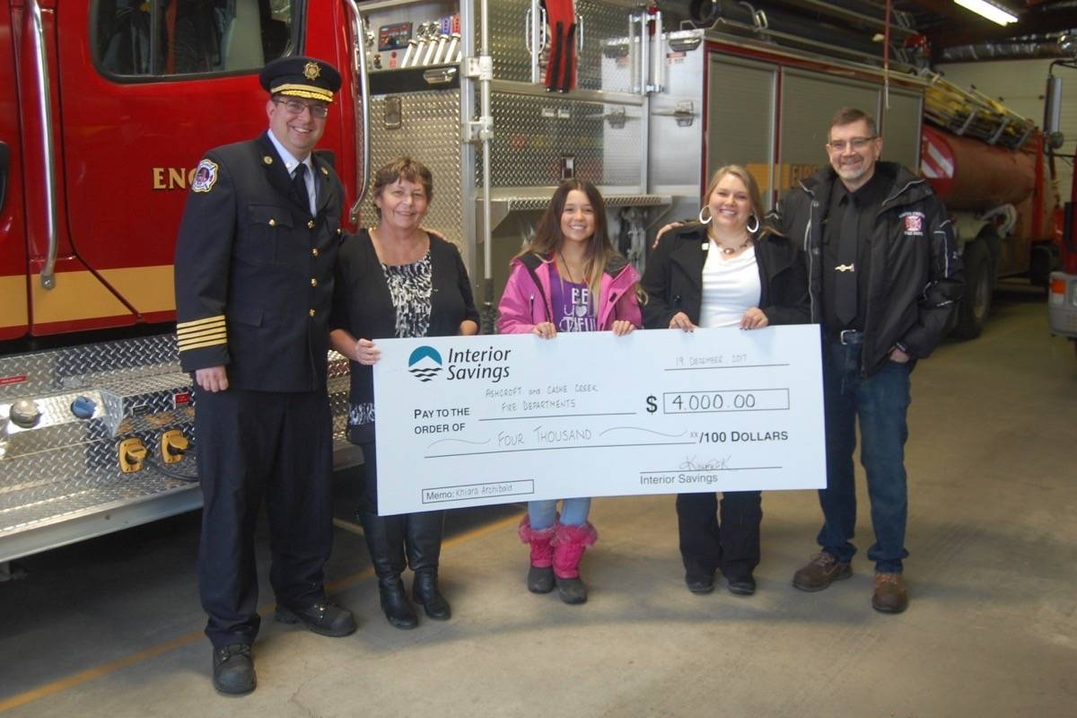 With the help of Interior Savings Credit Union, Khiara Archibald (centre) raised $6,000 for the Ashcroft and Cache Creek fire departments. Khiara is pictured (from left) with Ashcroft fire chief Josh White; Ashcroft Interior Savings Credit Union accounts manager Kellie Niessen and branch manager Karma Kubbernus; and Cache Creek fire captain Bill Elliott. Photo: Barbara Roden.