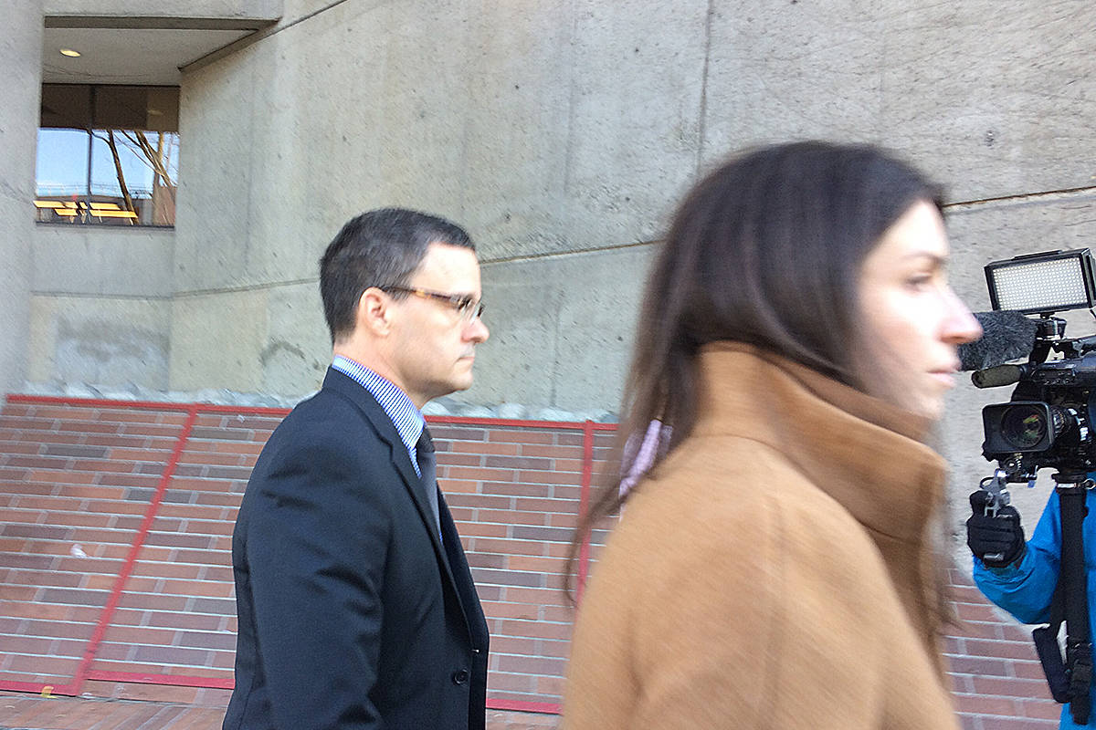 Former RCMP spokesperson Tim Shields leaves court Wednesday with one of his attorneys. (Katya Slepian photo)