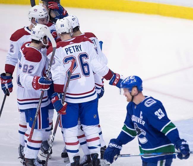 Canadiens down Canucks 7-5