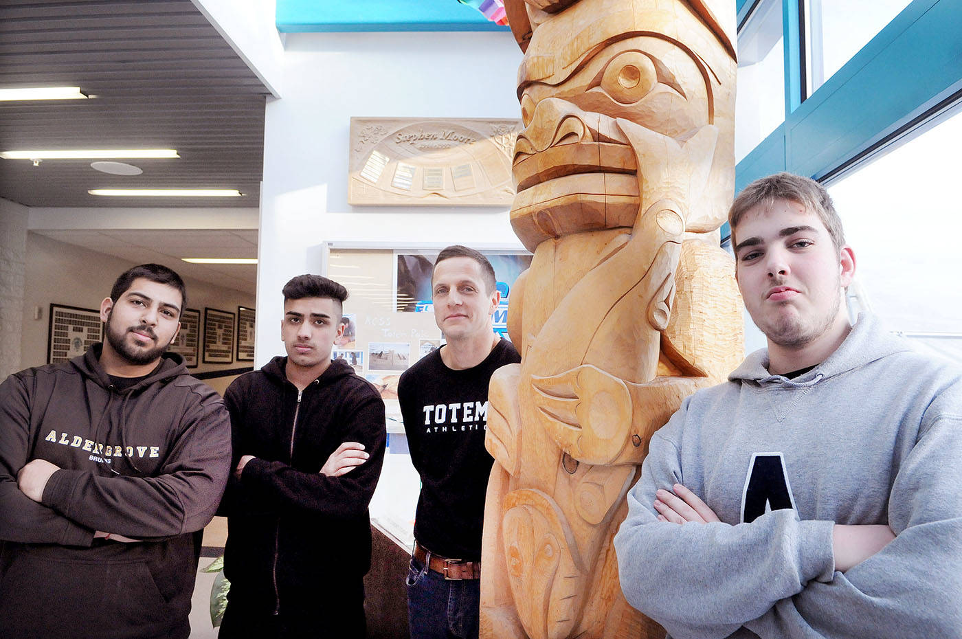 Aldergrove Community Secondary School (ACSS) teacher Art Glauser (third from left) and leadership students Mandeep Paul, Jashan Brar and (far right) Josh Hatch fundraised recently in support of a local refugee family, in time for Christmas. Troy Landreville Langley Times