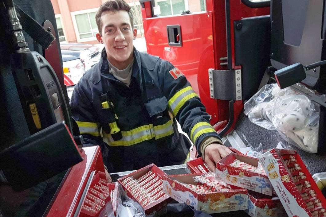 Langley Township firefighter Nicholas Johnston unpacked treats for the annual Candy Cane Run with Santa at the Murrayville fire hall in 2016. The event returns this year on Saturday, Dec. 23. Langley Times file photo.
