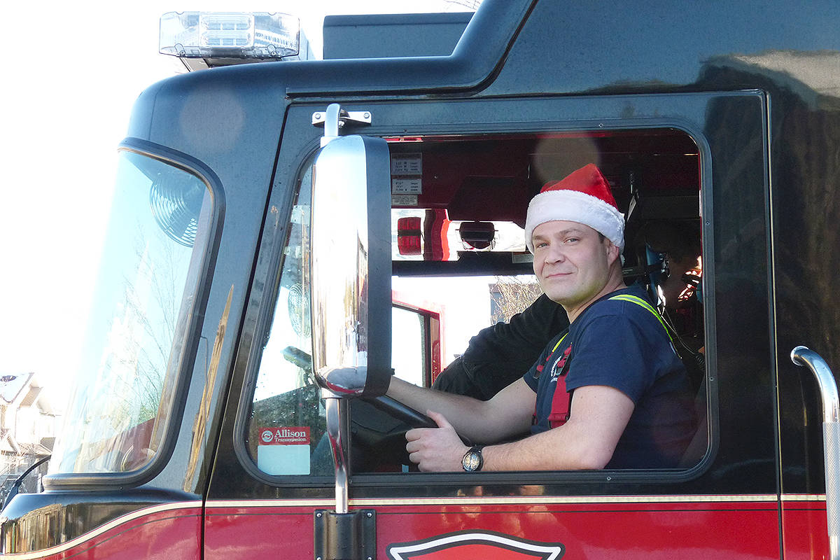 Township of Langley firefighter Darren De Jesus was one of the Firehall 6 paid-on-call members handing out candy canes in Murrayville Saturday. Dan Ferguson Langley Times