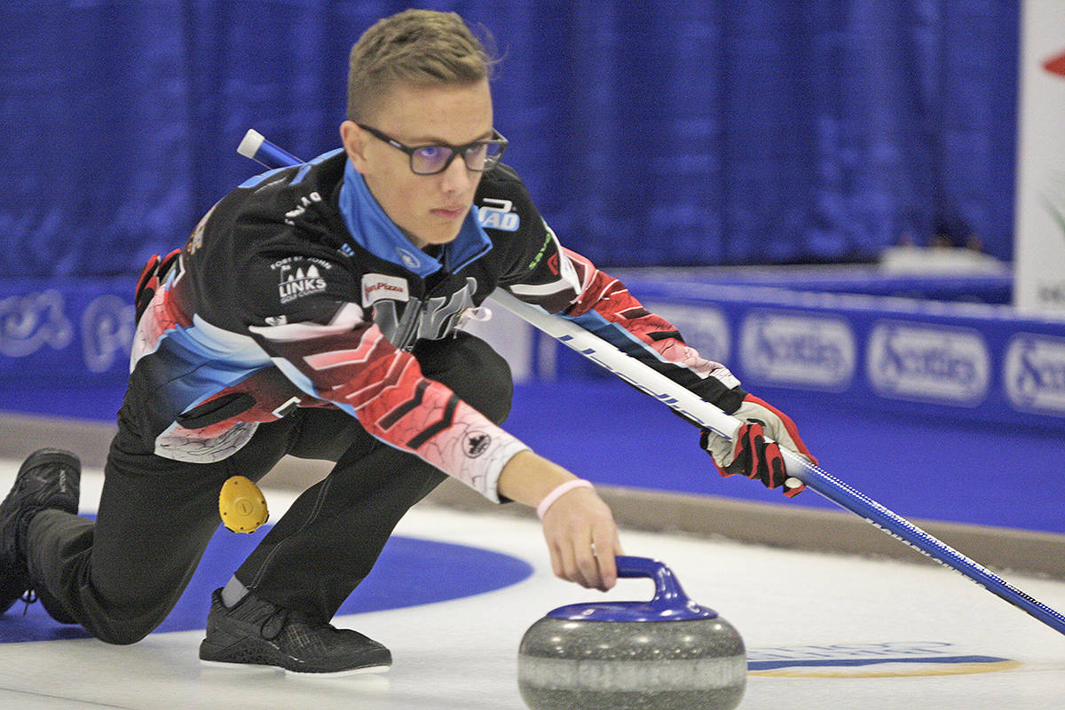 Zachary Curtis of Team Tardi lines up a shot Saturday at the BC Junior Curling Championships in Langley. Dan Ferguson Langley Times