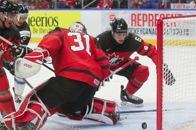 Cal Foote (Kelowna, B.C./Kelowna Rockets, WHL) diving behind Canada's National Junior Team goalie to stop the puck from crossing the line during Tuesday's 2018 IIHF World Junior Championship opening game against Finland. Photo courtesy of the World Junior Championship