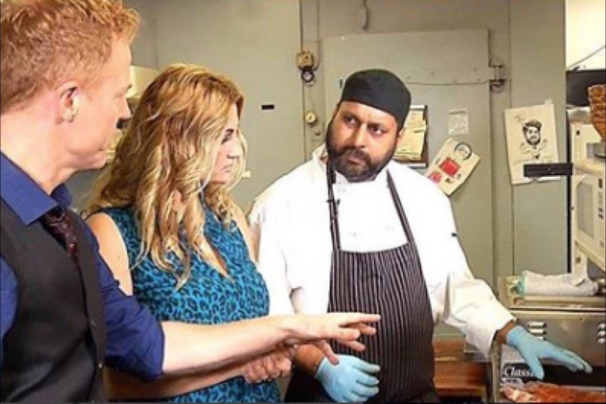 Actor David Lewis and Get Cooking with the Stars host Laurie Belle cook up ribs with Chef Rinku of NY Grill. (@getcookingwiththestars / Instagram)