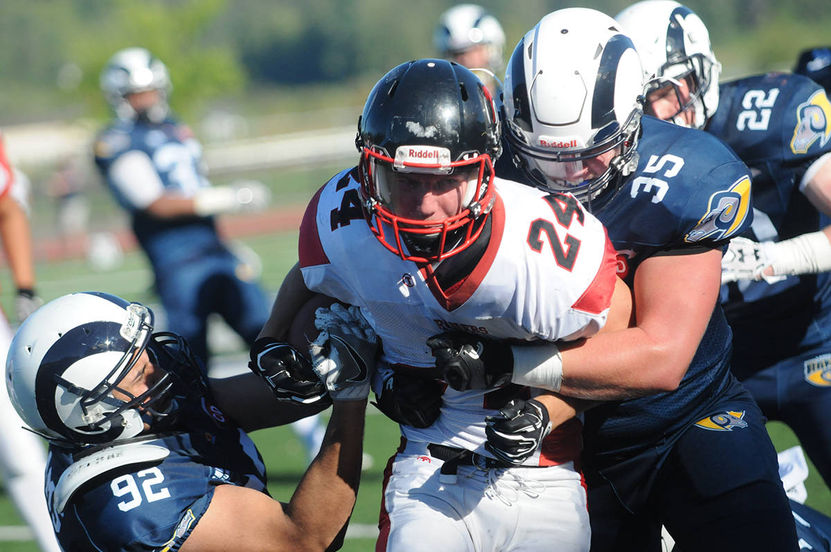 Langley Rams' Cameron Cross (#35) and Sonu Kainth team up to tackle VI Raiders' Rhett Williams during the BCFC season opener at McLeod Athletic Park on July 29. The Raiders won 20-13. Gary Ahuja Langley Times