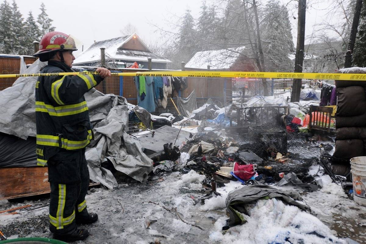 The Maple Ridge fire department tapes off an area around the scene of a tent fire at Anita Place tent city on Thursday. (Colleen Flanagan/THE NEWS)
