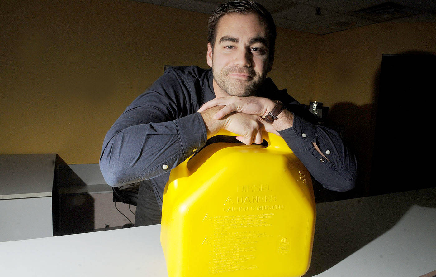 David Moerman, owner of Revive Washing, shows the containers that villagers use to carry water to their homes in developing countries. Troy Landreville Langley Times