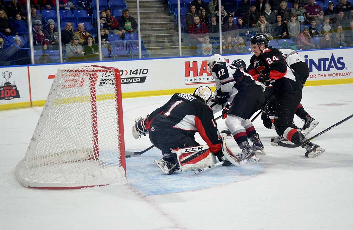 Vancouver Giants vs Prince George, WHL action at Langley Events Centre Jan. 1 Giants' Jared Dmytriw cuts across the crease to beat Prince George's Tavin Grant for the goal. Gary Ahuja Langley Times