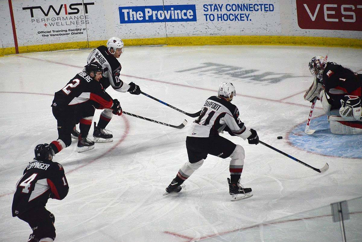 Vancouver Giants vs Prince George, WHL action at Langley Events Centre Jan. 1 Vancouver's Cyle McNabb and Aidan Barfoot c ould not beat Prince George's Tavin Grant. Gary Ahuja Langley Times