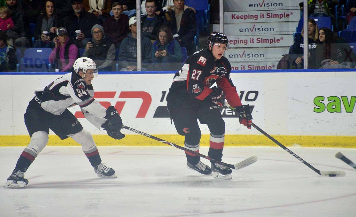 Prince George Cougars' Dennis Cholowski gets a step on Vancouver's Brayden Watts on his way to scoring the first goal in the WHL game at the Langley Events Centre on Jan. 1. Gary Ahuja Langley Times